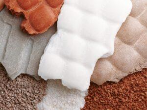 Material compactado para granulación